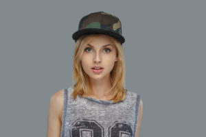   Portrait of modern hip hop female in a cap.